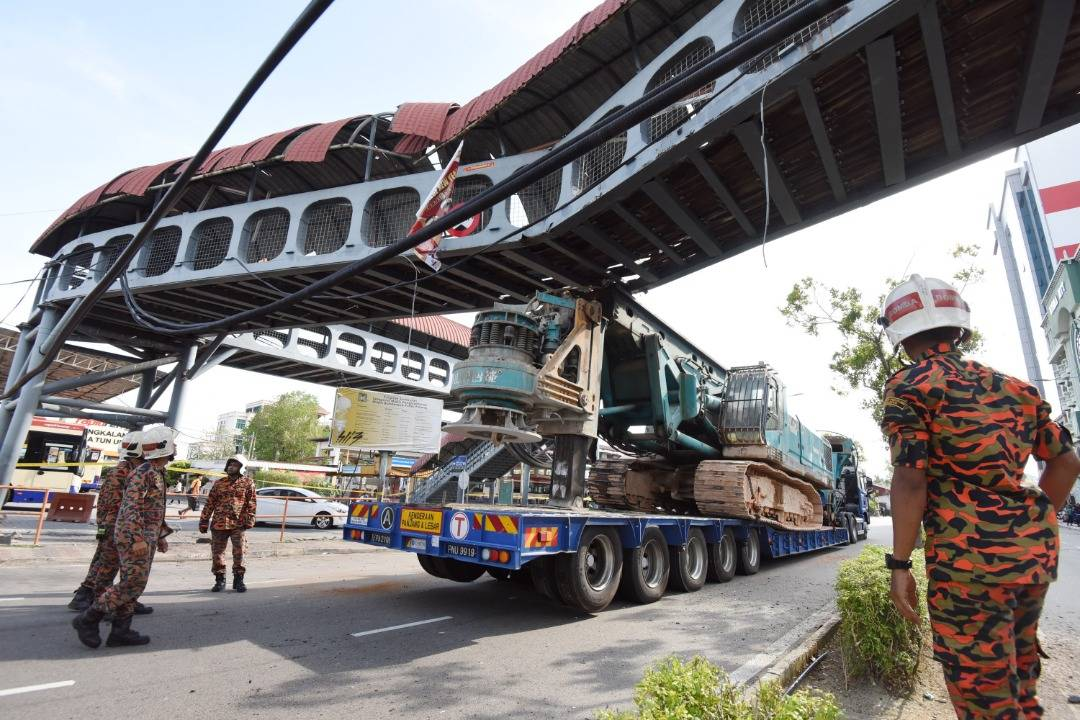 Pedestrian bridge near Penang ferry terminal damaged by piling crane